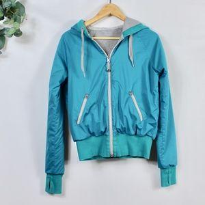 Lululemon turquoise rain jacket w/ hood